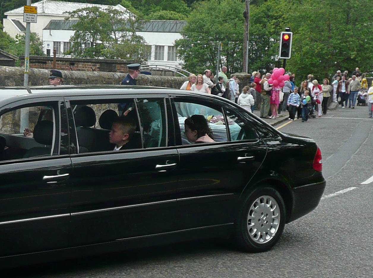 The limousine carrying the Tartan Queen and her Court