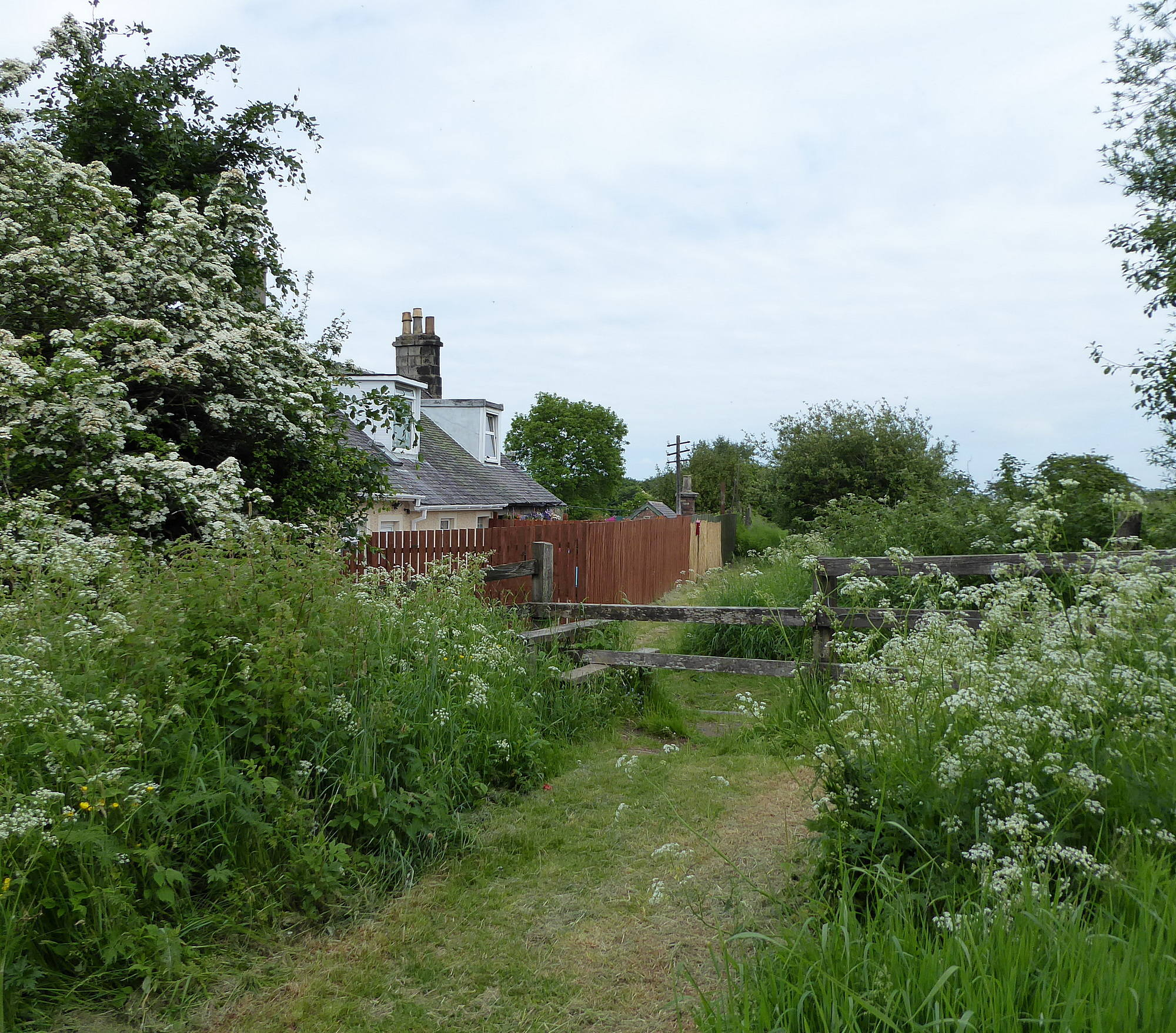 Railway cottages and style over railway path. 8th June 2018