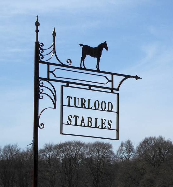 Turlood Equestrian Centre is on the Stockbriggs Estate. This is the  sign in Cumberhead Road
