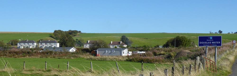 The village of Douglas Water with the Welcome sign from the North.